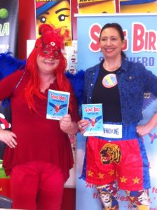 Song Bird Superhero meets Captain Cybersafe at the launch.